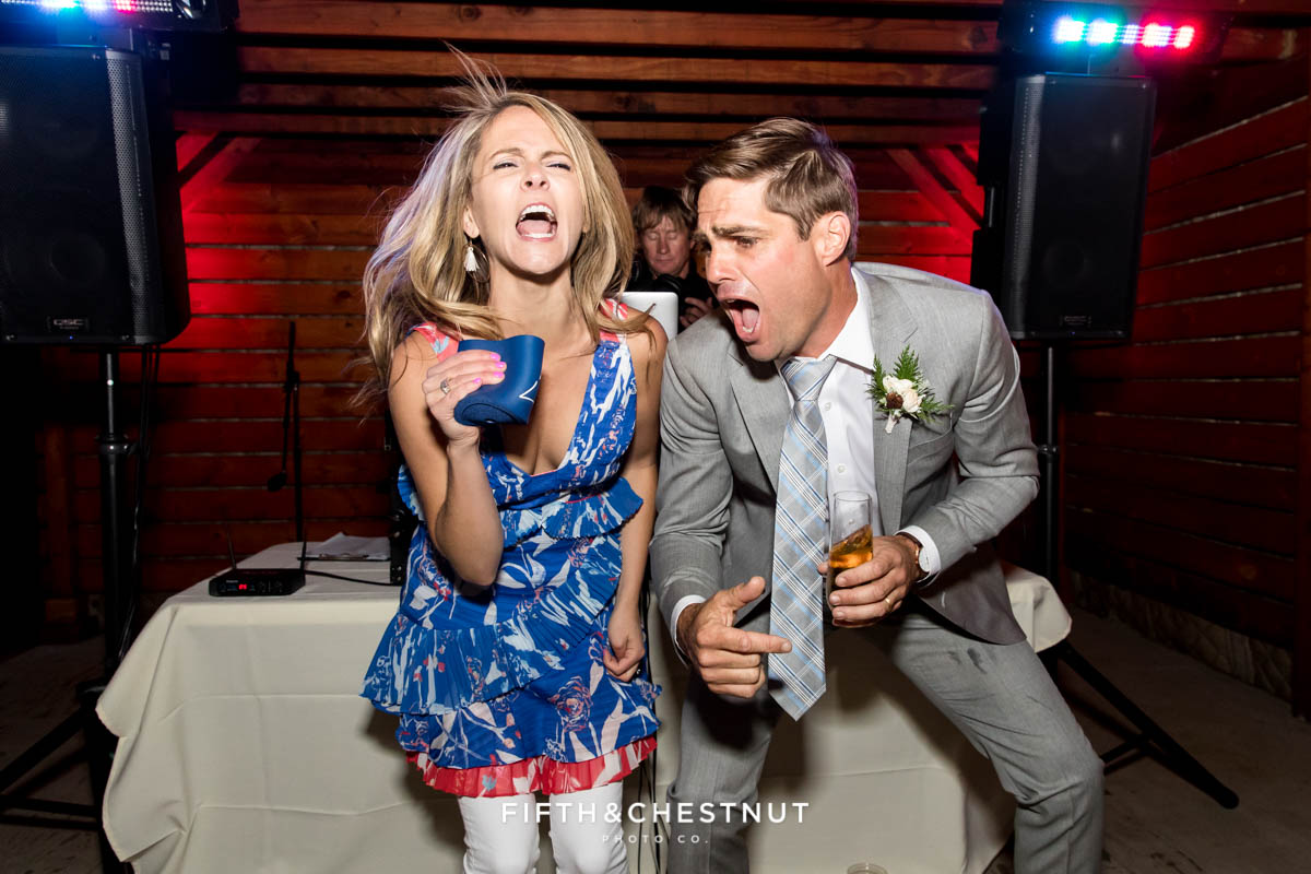 """groom and guest lip sync to whitney houston's """"I wanna dance with somebody"""" at a tahoe wedding"""