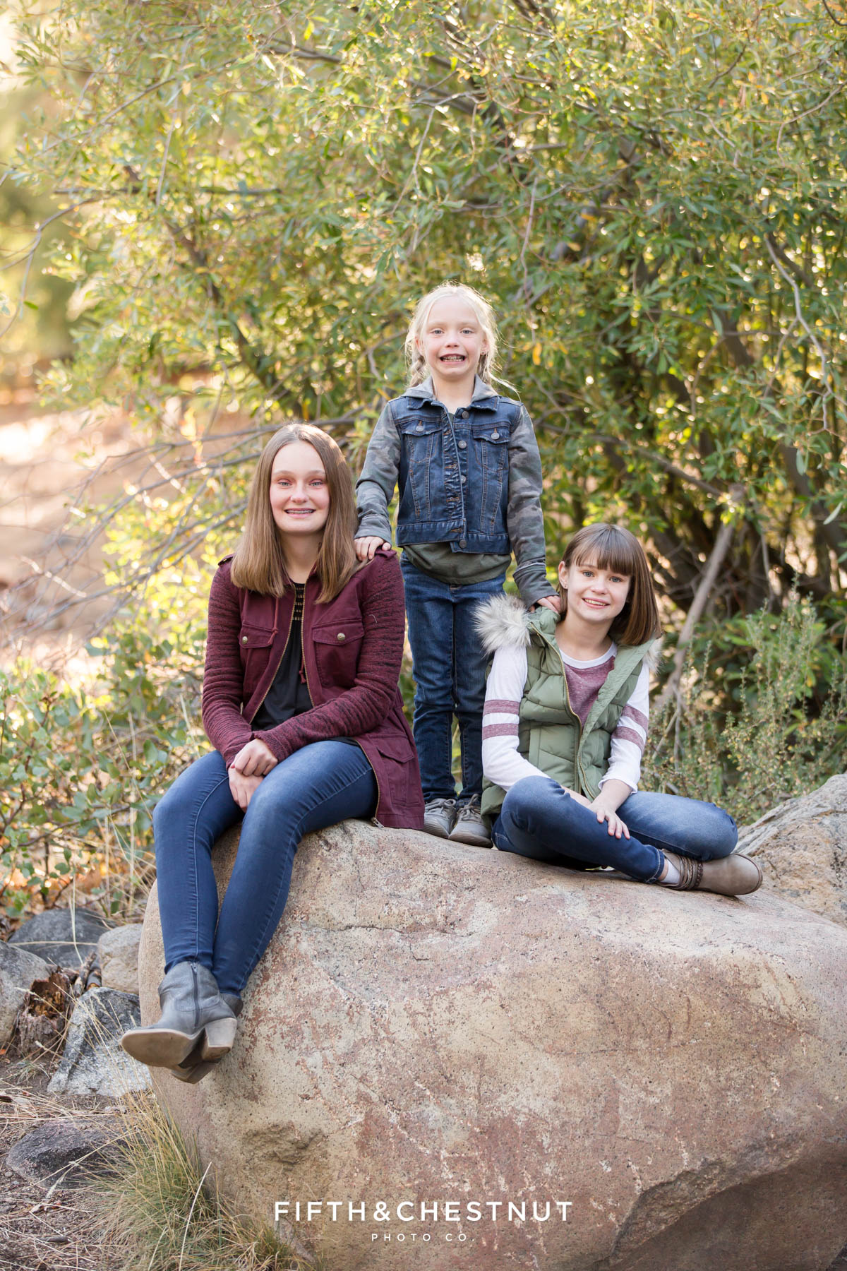 sisters pose for a picture on a rock for their Galena Creek Reno fall portraits