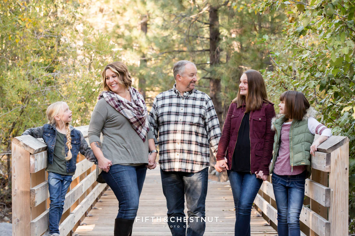 family stands across galena creek park bridge for Galena Creek Reno fall portraits