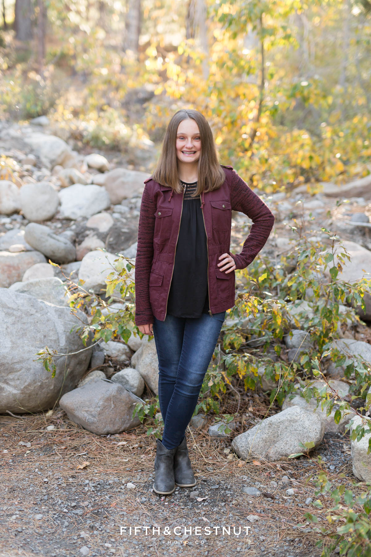 teenage girl in burgundy jacket poses for Galena Creek Reno fall portraits by Reno Family Photographer