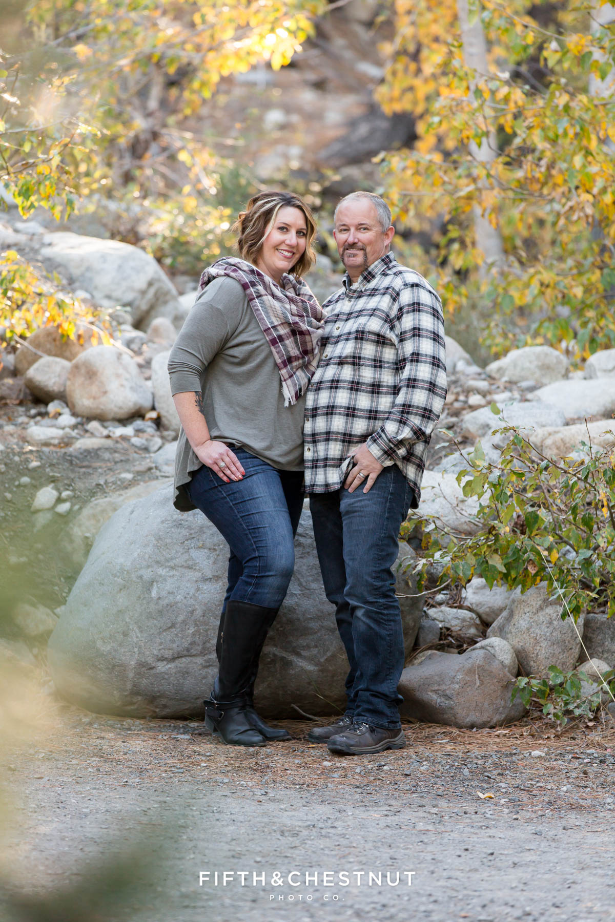 a mother and father stand together during Galena Creek Reno fall portraits by Reno Family Photographer