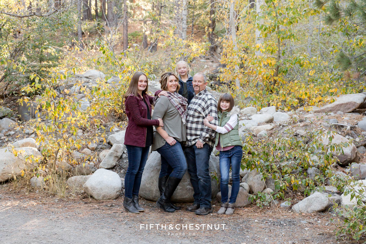 a family snuggles close together for Galena Creek Reno fall portraits by Reno Family Photographer