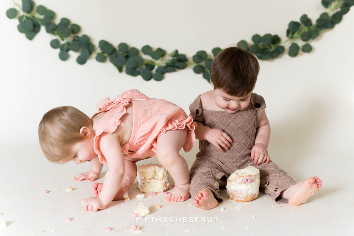 Cute bohemian cake smash for twins by Reno Baby Photographer