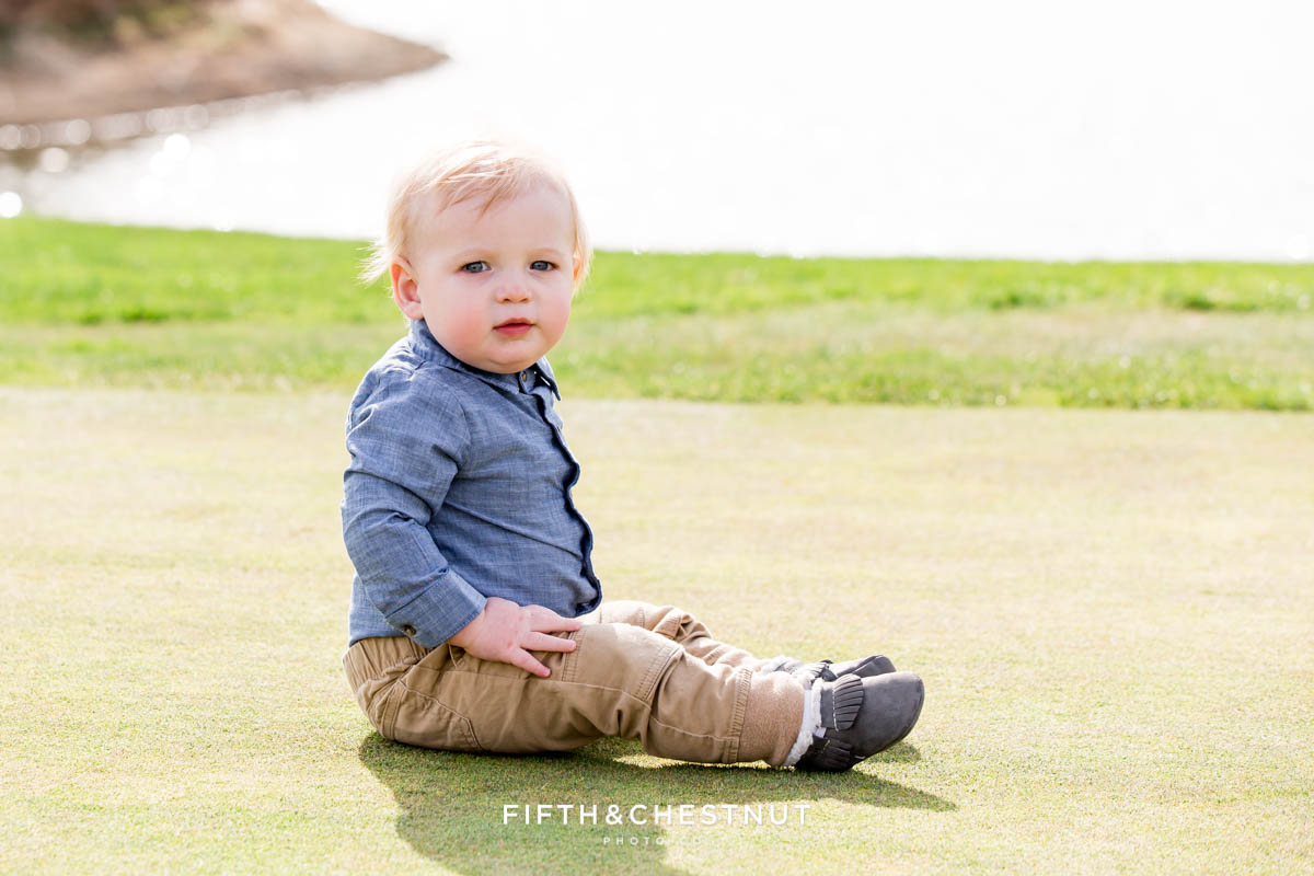 Baby boy in chambray, khaki and moccasins for his Golf Themed One Year Photos by Reno Baby Photographer