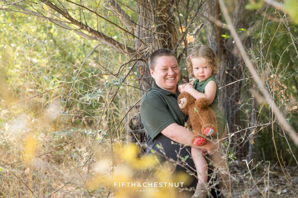Mother and daughter next to a fall tree at the Oxbow Nature Study in Reno
