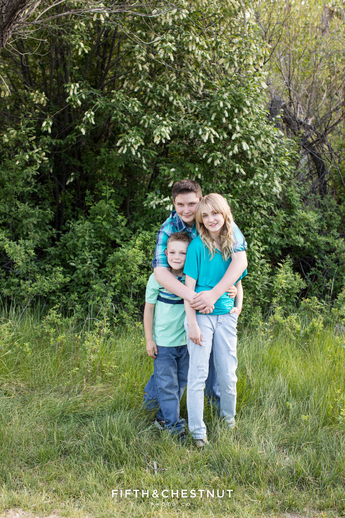 three kids wearing colorful colors for their reno family portraits at crystal peak park